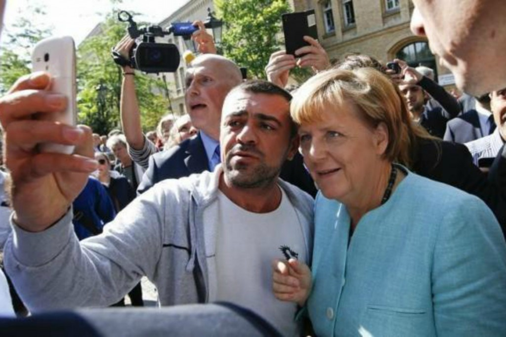 merkel_with_refugee